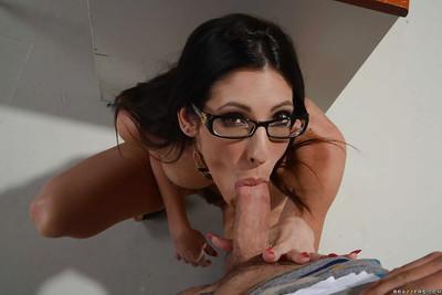 Glasses wearing schoolteacher Dava Foxx blowing student