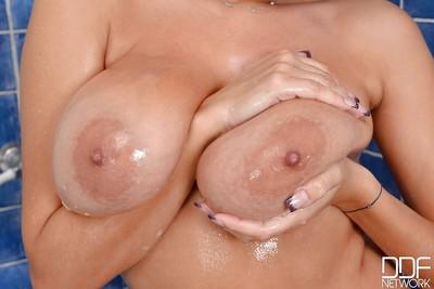Dangerously hot milf Sensual Jane shows off her giant tits in the bath