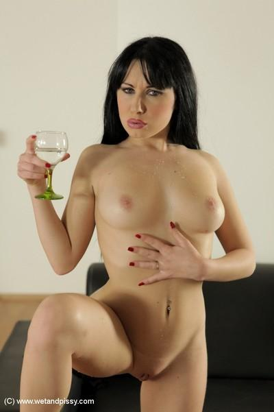 Milf Luna Ora is pissing in the wineglass and playing with pussy