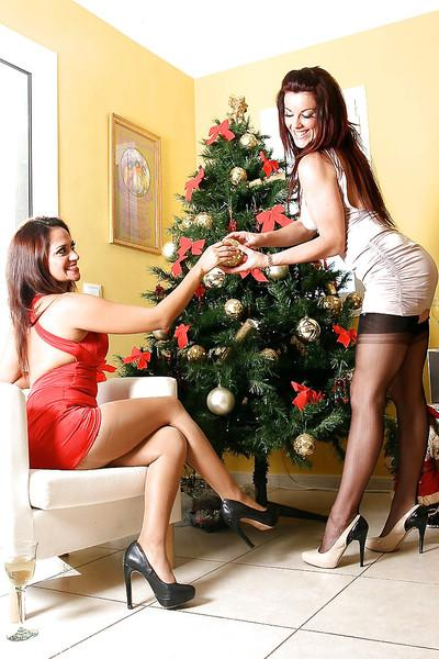 Nylon and garter adorned ladies get into Christmas spirit with lesbian sex