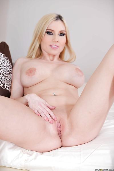 Petite blonde housewife Christie Stevens masturbating shaved vagina