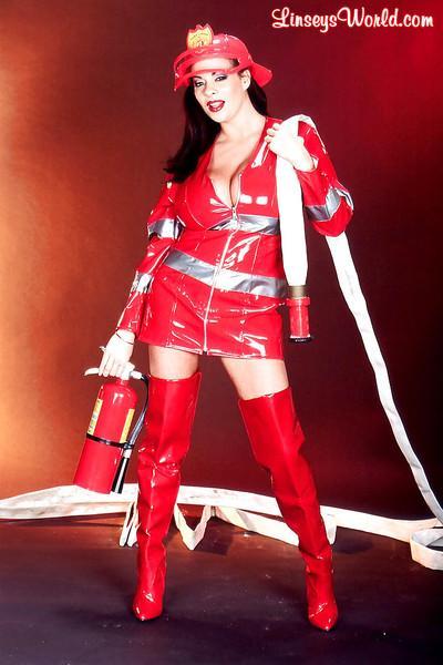 Linsey Dawn McKenzie dresses up her huge hooters in latex fireman uniform.