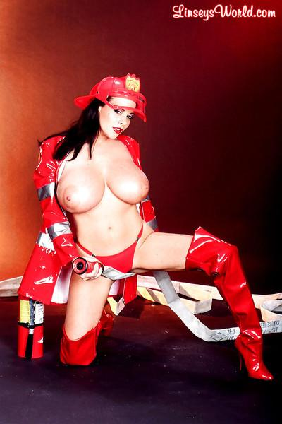 Linsey Dawn McKenzie dresses up her huge hooters in latex fireman uniform.