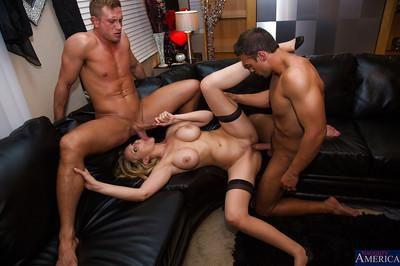 Great blowjob is done in a threesome sex by Julia Ann to two guys
