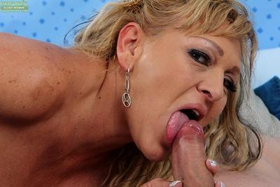 Beautiful mature MILF Andrea sucking on a young stud