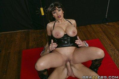 Wild MILF Sienna West dressed in latex jumps on a hard cock
