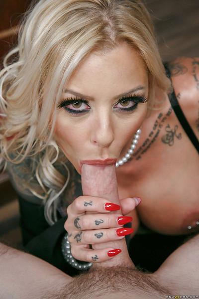 Chesty blonde MILF Britney Shannon exposing her pierced nipples