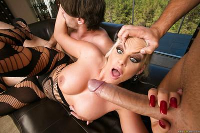 Top-heavy MILF in nylon outfit has some double penetration fun with big cocks