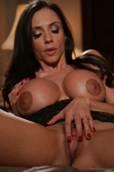 Top heavy Latina MILF Ariella Ferrera posing sexily on bed in lingerie