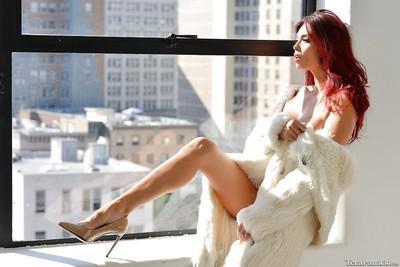 Leggy MILF pornstar Tera Patrick unveils large tits and tats in high heels