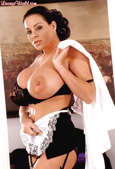 Sexy BBW maid Linsey Dawn McKenzie poses in her uniform and high heels.