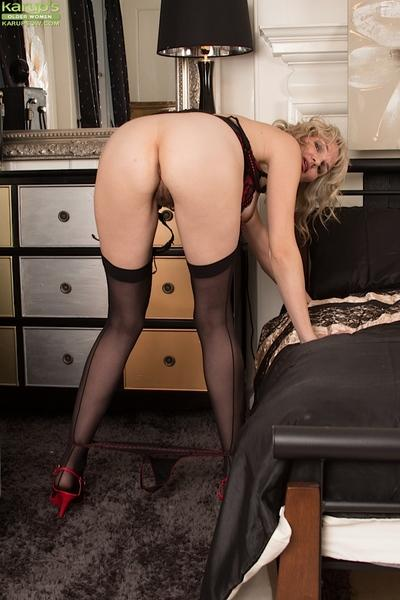 Mature babe with a hairy cunt Roxy Jay is showing off in stockings