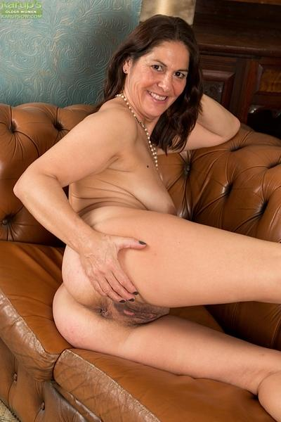 Pantyhose attired MILF babe reveals big boobs and ass in high heels