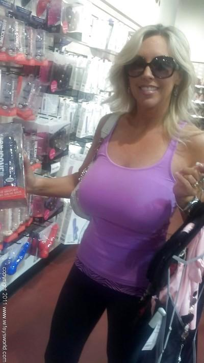 Sporty blonde busty MILF in sun glasses Wifey posing outdoor