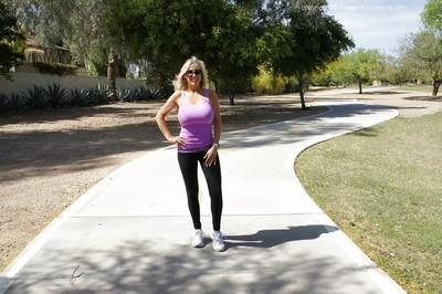 Sporty blonde busty MILF in sun glasses Wifey posing outdoor