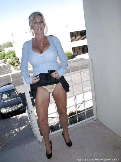 Hot MILF Wifey does some upskirt and exposes her huge boobs