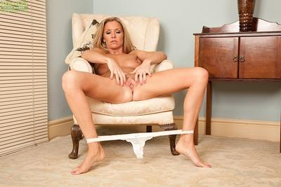 Blonde European MILF Louise Dakotah flashes panties before stripping naked