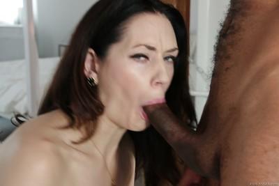 Brunette MILF Sarah Shevon gives a big black dick a messy blowjob