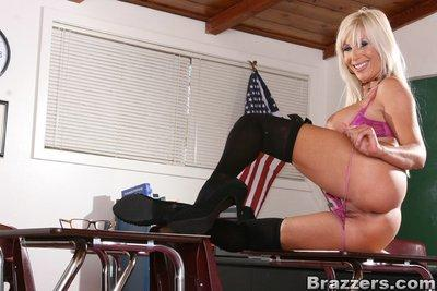 Insanely sexy teacher Puma Swede denudes her MILF hooters in class