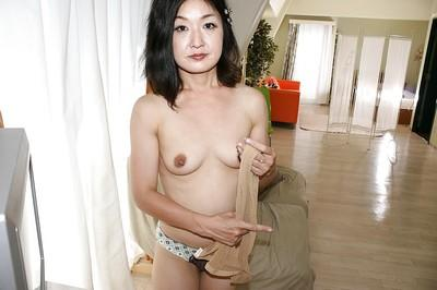 asian lady Chiyo Yamabe taking off her panties and toying her hairy twat