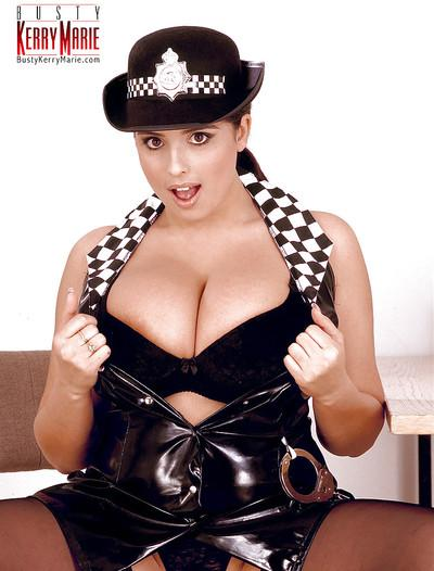 Chubby MILF pornstar Kerry Marie freeing huge boobs from police uniform