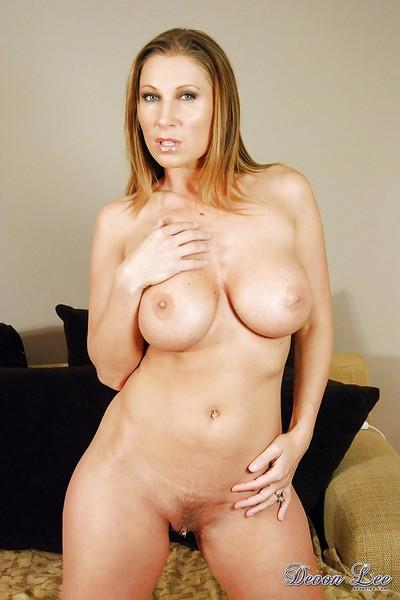 Blonde pornstar Devon Lee showing off big natural juggs and pierced pussy