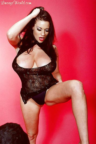Brunette busty BBW Linsey Dawn McKenzie does a hot striptease.