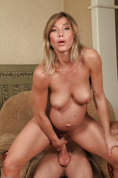 Horny blonde pregnant slut Rita Rush taking a deep anal drilling