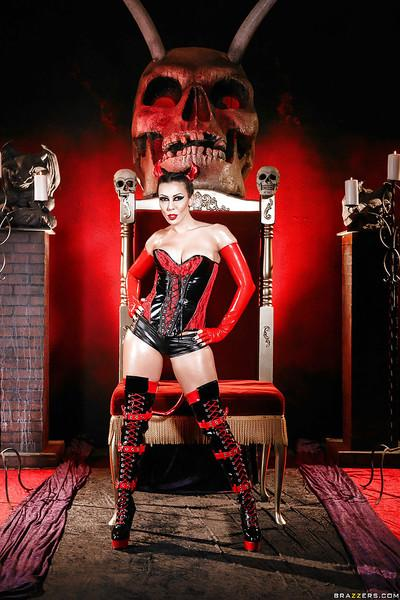Kinky cosplay model Rachel Starr modeling naughty latex uniform and boots