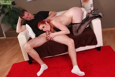Horny mom Genny Red giving a blowjob wearing black stockings