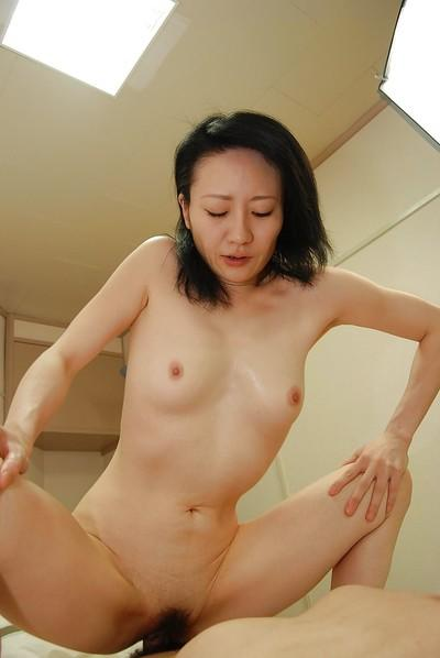 Asian MILF gives head and has some pussy toying and fucking fun