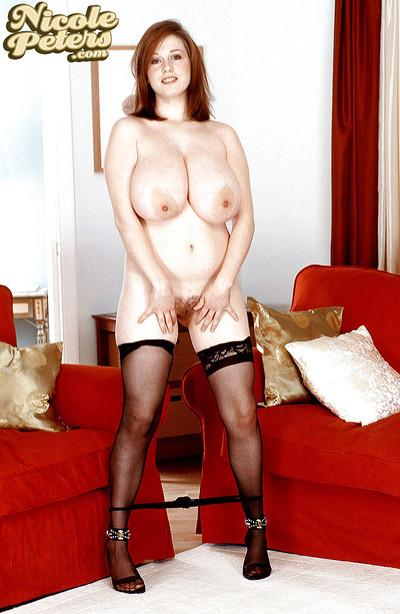 Amateur redhead solo girl Nicole Peters flaunting huge hooters in stockings