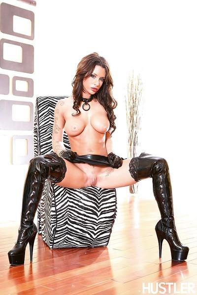 Milf pornstar Mya Nichole demonstrates her ass in a latex suit