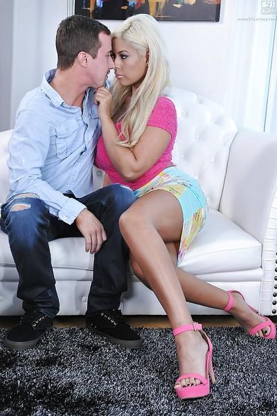 Buxom Latina cougar Bridgette B seduces a younger man and his large penis
