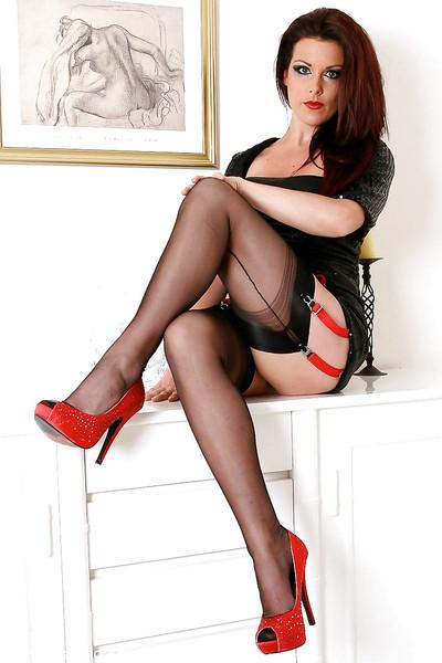 Brunette MILF from Europe striking sexy poses in black nylons and heels