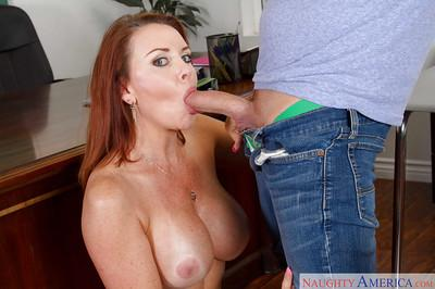 Older redhead teacher Janet Mason gives student passing mark after oral sex