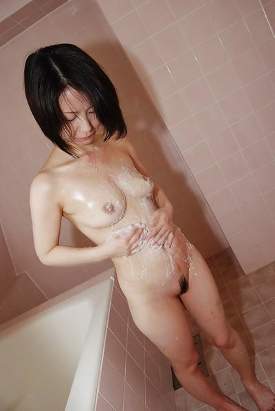 Asian MILF taking shower and teasing her hairy gash with water jets