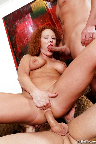Lewd MILF Audrey Hollander enjoys two rigid dicks filling her shaved holes
