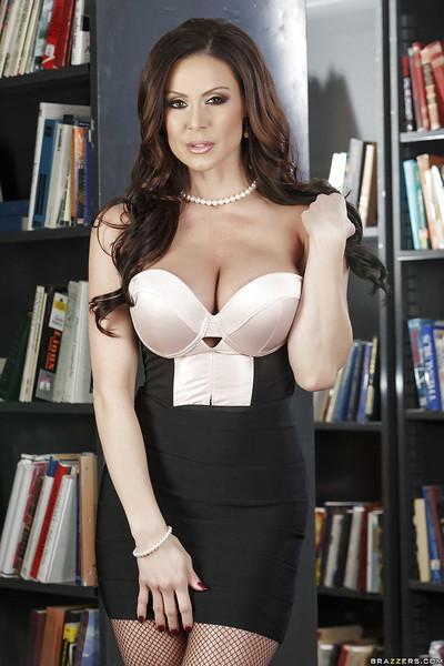 Busty MILF Kendra Lust is looking hot as school librarian in glasses