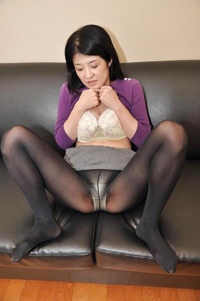 Asian MILF Satoko Miyazawa stripping down and playing with sex toys