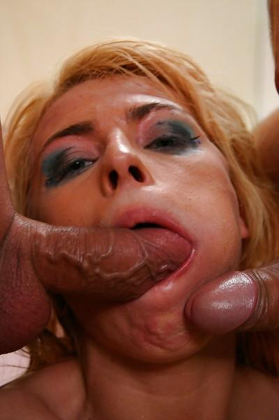 Allyson Moore enjoys double penetration and gets her face glazed with jizz