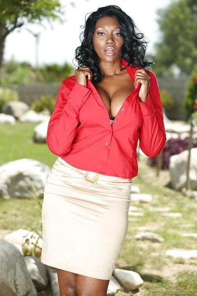 Curvy ebony MILF Nyomi Banxxx stripping off her suit and lingerie outdoor