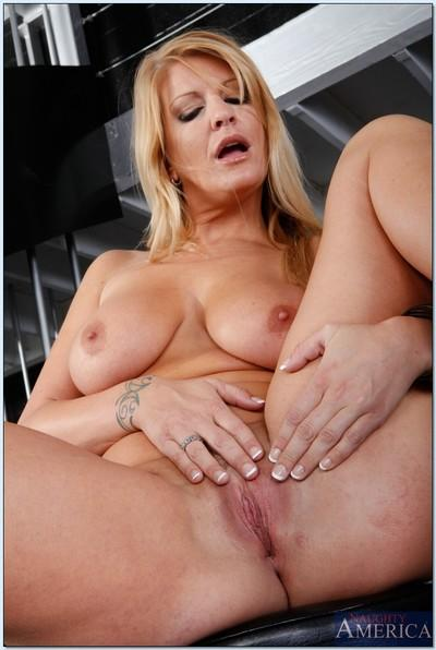 Sexy MILF blonde Robbye Bentley showing off ripe ass and huge hooters