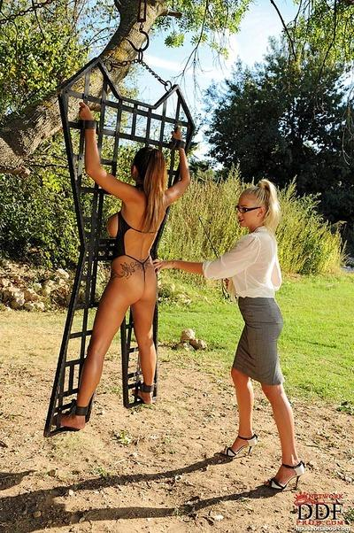 Strict MILF in glasses whipping and spanking her busty slave girl