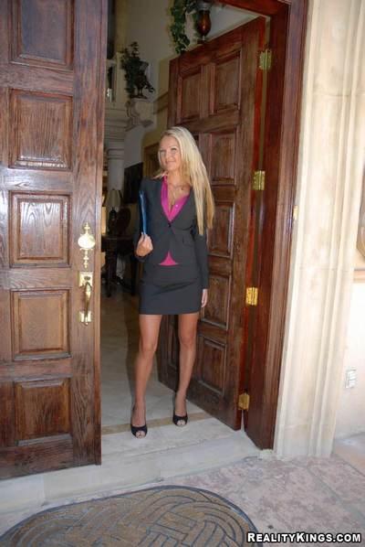 Busty milf secretary on high heels gets cumshot in her face