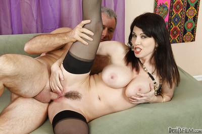 Juggy MILF fucks a big cock and gets her trimmed bush glazed with cum