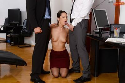 European brunette Angie Moon deepthroats cock in office during MMF threeway