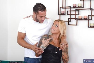 Marvellous blonde whore with tattoo Britney has some cum on her tits