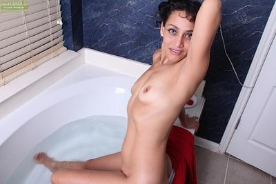 Housewife Cielo gets in bathtub and spreads pussy until clitoris pops up