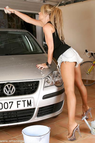 Blonde MILF model from Europe flashing underboobage while washing car